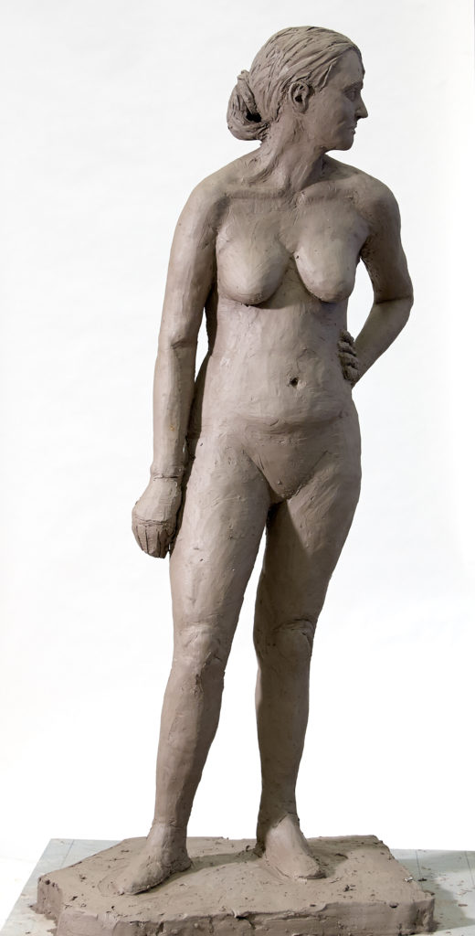 standing woman clay sculpture